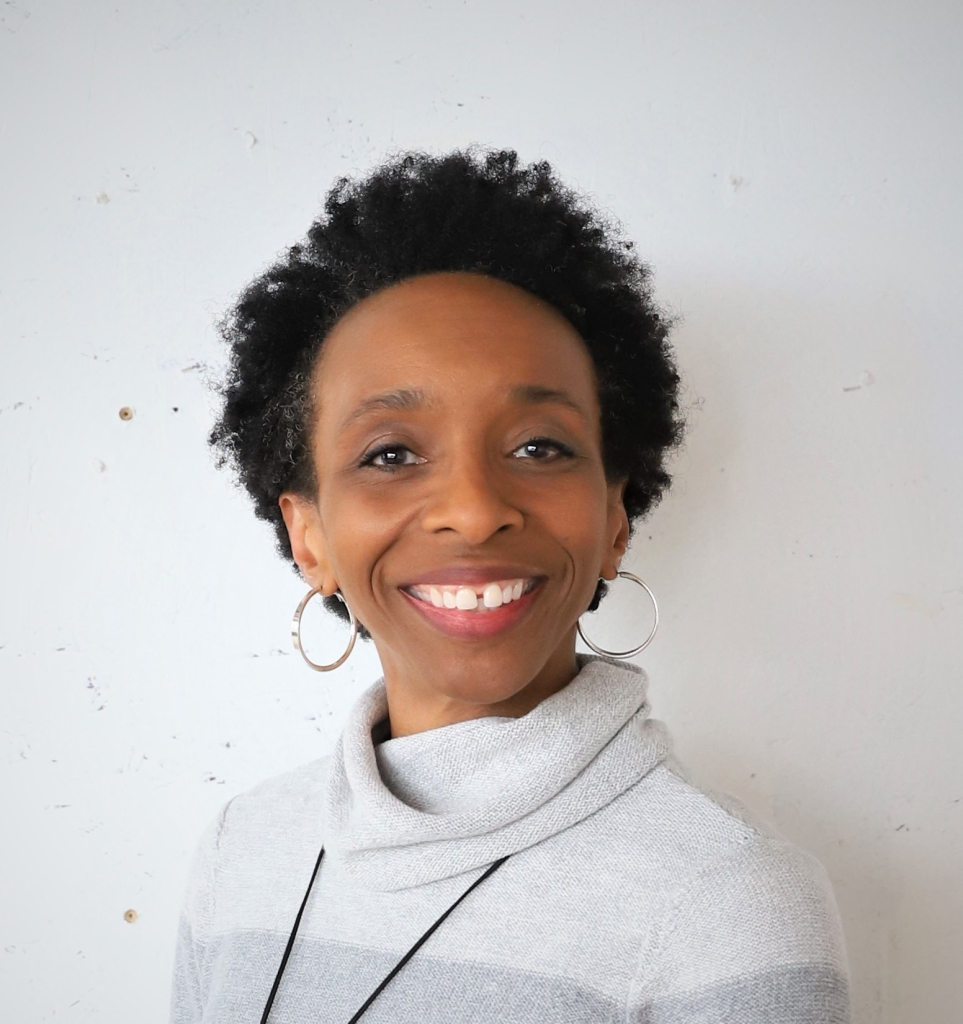 Black woman with natural hair with smile and open expression